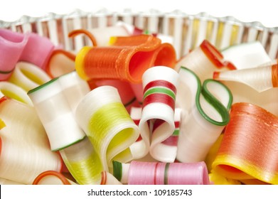 A bowl of colorful hard ribbon candy, perfect for the Christmas holidays
