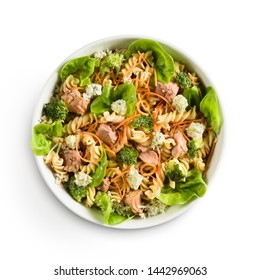 Bowl with colorful pasta salad, gorgonzola cheese, broccoli, carrots, tuna fish, on a white background