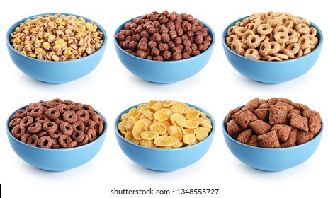 Bowl with corn pads, rings, balls, oat granola and cornflakes isolated on white background. Cereals breakfast collection with clipping path.
