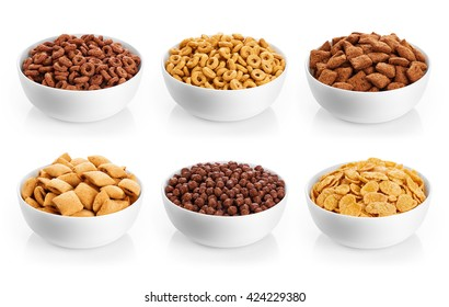Bowl with corn pads, rings, balls and cornflakes isolated on white background. Cereals breakfast collection.