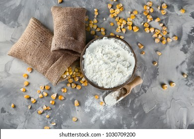 Bowl with corn starch and kernels on table
