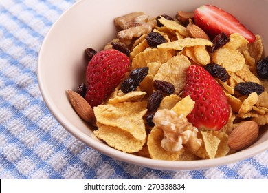 Bowl of cornflakes with fruit