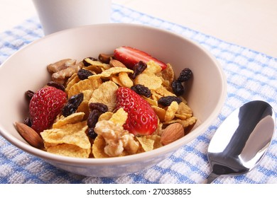 bowl of cornflakes with fruits