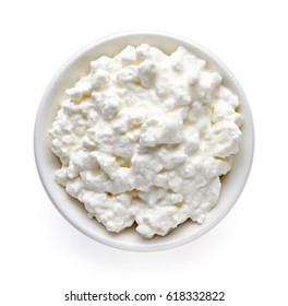 Bowl of cottage cheese isolated on white background, top view
