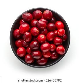 Bowl of cranberries isolated on white background, top view