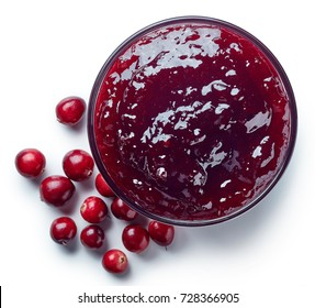 Bowl of cranberry jam isolated on white background from top view