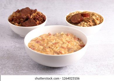 A Bowl of Crawfish Etouffee with Gumbo and Red Beans and Rice on the Side