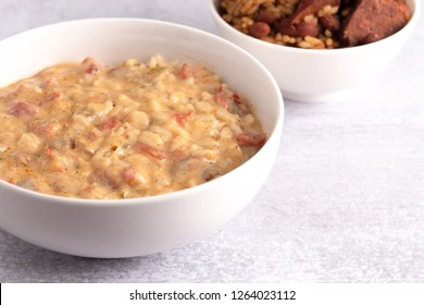A Bowl of Crawfish Etouffee with Red Beans and Rice on the Side