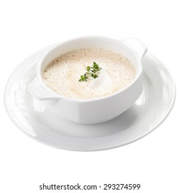 Bowl of cream soup isolated on white background