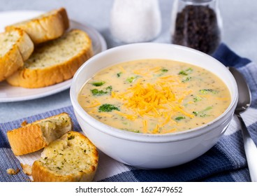 Bowl of creamy broccoli cheddar cheese soup with toasted cheese bread