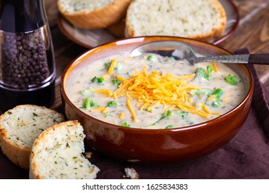 Bowl of creamy broccoli cheddar soup with toasted cheese bread