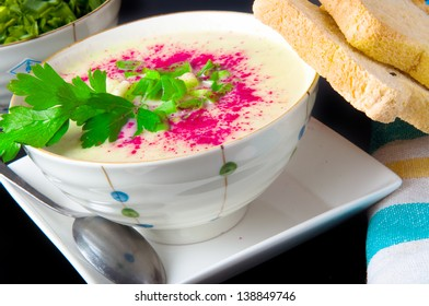 Bowl of creamy cauliflower soup with  parsley