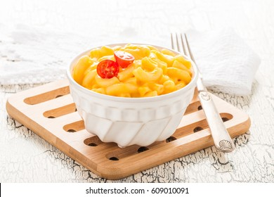 Bowl of creamy homemade macaroni and cheese.