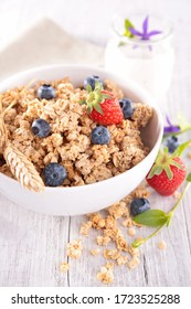 bowl of crunchy cereal and blueberry
