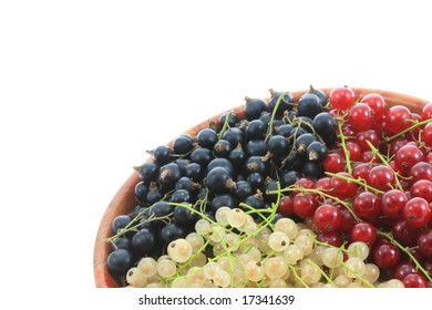 Bowl of currants isolated on a white background.