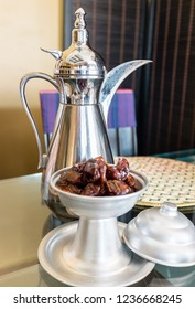 A bowl of dates and a dallah pot with Arabic coffee - known as gahwa in Arabic - in Oman