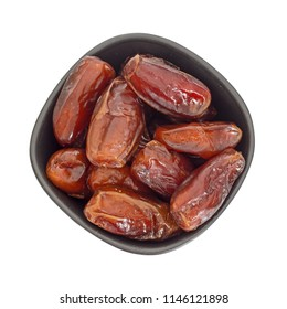 Bowl of dates isolated on white background, top view - festive food.