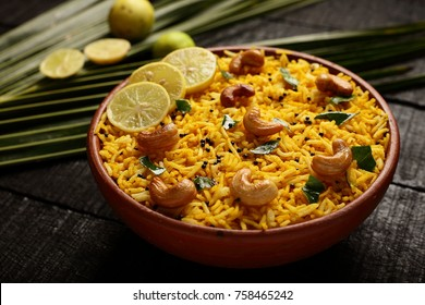Bowl of delicious  fried rice served on a wooden table.