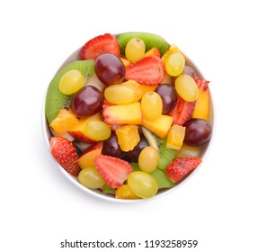 Bowl with delicious fruit salad on white background