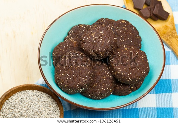 Bowl of delicious healthy dark chocolate and chia seed cookies with ingredients