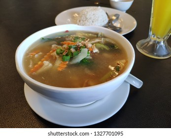 A bowl delicious and healthy mixed vegetables soup on the table.