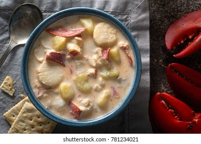A bowl of delicious homemade seafood chowder with lobster, scallops, haddock, clams, and potato.