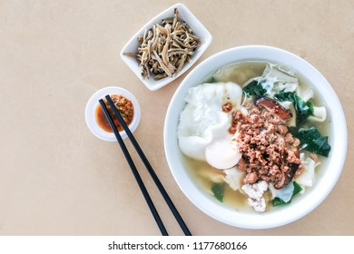 Bowl of delicious Pan Mee noodle soup, popular Chinese food in Malaysia.