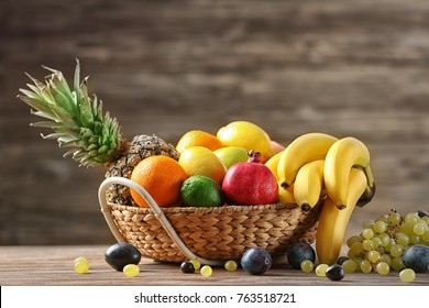 Bowl with delicious ripe fruits on table