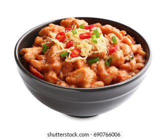 Bowl with delicious turkey chili on white background