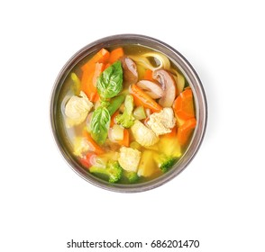 Bowl with delicious turkey soup, isolated on white