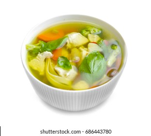 Bowl with delicious turkey soup on white background