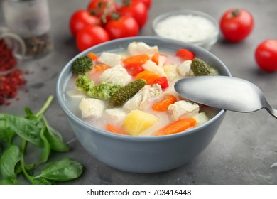 Bowl with delicious turkey soup on table