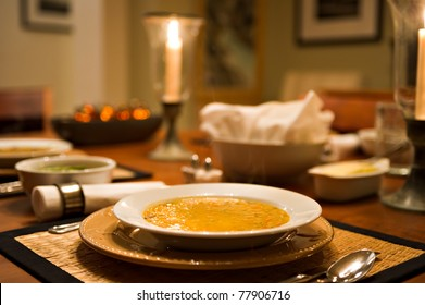 A bowl of delicious vegetable soup on a beautifully set table