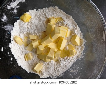 Bowl of dice butter and flour.