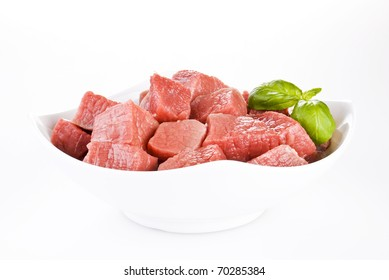 Bowl of diced beef over white background