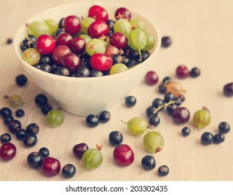 bowl with different fresh berries bright, summer still life, in soft focus, with instagram retro effect