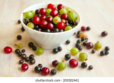 bowl with different fresh berries bright, summer still life, in soft focus