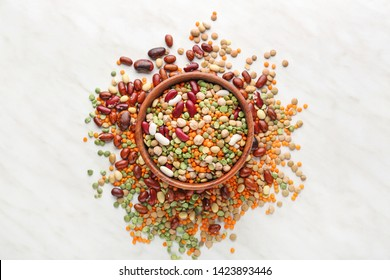Bowl with different legumes on  table