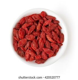 Bowl of dried goji berries isolated on white background, top view