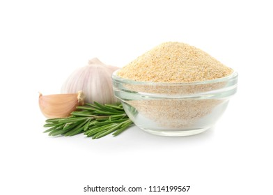 Bowl of dry garlic powder and rosemary on white background