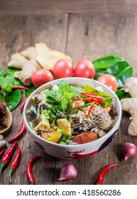 a bowl of fish soup sour and spice on old wooden background. Vietnamese Sour Fish Soup. Viet Nam food, canh ca chua,