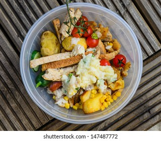 A bowl of food recycling waste on a wooden background