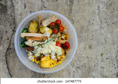 A bowl of food recycling waste on a stone background