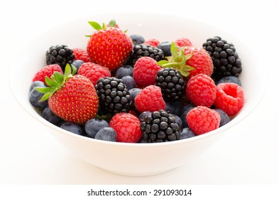 Bowl of fresh berries: raspberry, blackberry, blueberry and strawberry