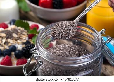 Bowl of fresh fruit. Blackberries; raspberries; blueberries on a bowl. Healthy breakfast. Vegetarian organic meal.