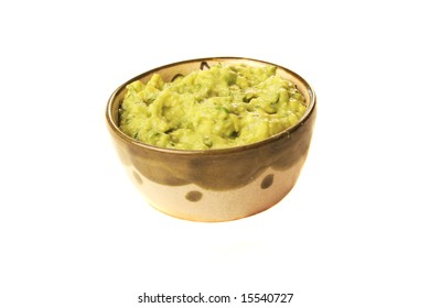 A bowl of fresh guacamole isolated on white