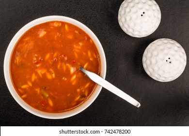 Bowl of Fresh Italian Style Minestrone Soup Against a Black Background