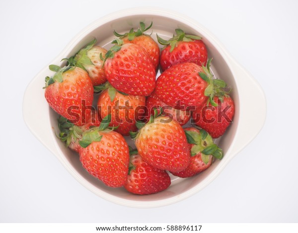 a bowl of Fresh Korean Strawberries on a white background