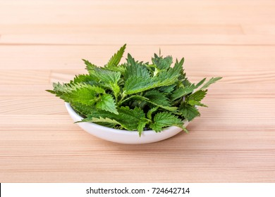 Bowl with fresh nettle leaves
