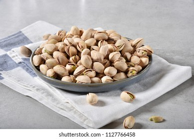 A bowl of fresh organic pistachio nuts, a healthy snack